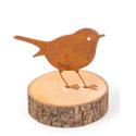 Oiseau en métal sur une tranche de bois